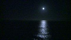 night, full moon at sea - stock footage