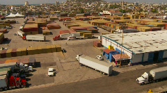 Container port and trucks, big high dolly shot, wide Stock Footage