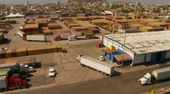 Stock Video Footage of container port and trucks, big high dolly shot, wide