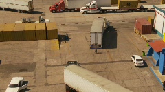 container port and trucks, big high dolly shot, medium shot - stock footage
