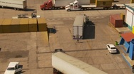 Container port and trucks, big high dolly shot, medium shot Stock Footage