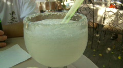 Drinking a margarita on an outdoor patio, a warm afternoon Stock Footage