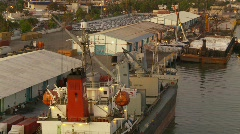 Marine transportation, cargo ships in port at dusk Stock Footage
