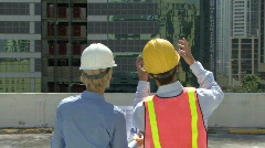 Male and female construction workers on a site Stock Footage