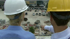 View on construction workers inspecting a site Stock Footage