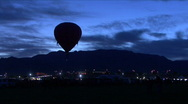 Stock Video Footage of Silhouette Hot Air Balloon Against Mountains