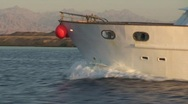 Stock Video Footage of Bow of a boat sailing close to desert shoreline