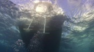 Stock Video Footage of Back deck of dive boat in ocean swell - underwater view