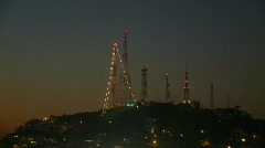 TV transmitter towers at night Stock Footage