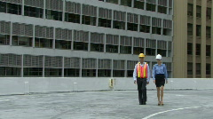 Portrait of a male and female on a construction site Stock Footage
