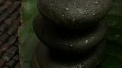 Zen rocks on leaf zoom out - HD - stock footage