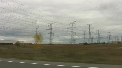 Driving past hydro towers. Stock Footage