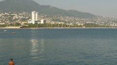 Acapulco skyline and beach, #4 pan - stock footage