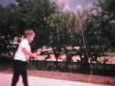 Stock Video Footage of Little Boy With New Fishing Rod (1965 - Vintage 8mm film)