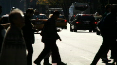 Backlit Anonymous Pedestrians - stock footage