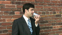 Man on tincan phone. 1 of 2. Stock Footage
