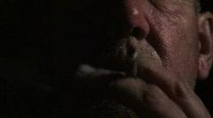 Man smoking a cigar at night 1 Stock Footage