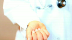 Doctor hand offering pills Stock Footage