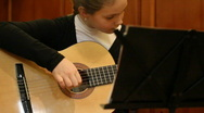 Stock Video Footage of girl plays a guitar.
