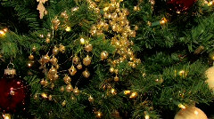 Christmas tree with golden ornaments.  Pan Up Stock Footage