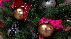Christmas tree with shinny ball ornaments and ribbons.  Stock Footage