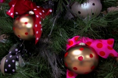Christmas tree with shinny ball ornaments and ribbons.  Pan Up.  Stock Footage