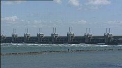 Deltaworks Oosterscheldedam pijlerdam stormvloedkering 502001 013243 Stock Footage