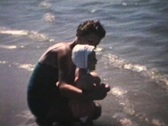 Stock Video Footage of Baby Goes To The Beach (1963 - Vintage 8mm film)