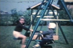Little Boy And Girl On Swing (1963 - Vintage 8mm film) Stock Footage