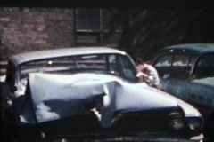 Inspecting A Smashed Up Car (1964 - Vintage 8mm film) Stock Footage