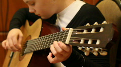 Girl plays a guitar. Stock Footage