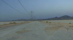 Zoom in on isolated road in desert Stock Footage