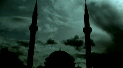 Time lapse clouds flowing past twin minaret mosque 3 Stock Footage