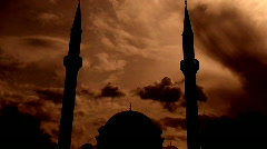 Time lapse clouds flowing past twin minaret mosque 4 Stock Footage