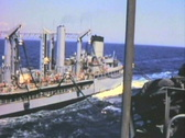 Alongside military ship--From 1960's film Stock Footage