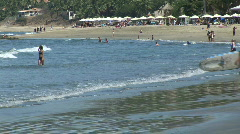 Mex surfer into water 049 Stock Footage