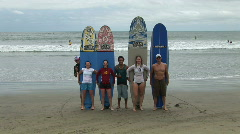 Mex surfers holding boards 060 Stock Footage