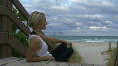 Female relaxing near a beach Stock Footage