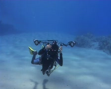 An Underwater photographer taking a picture with strobes - stock footage