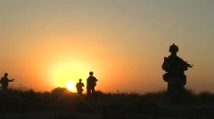 Stock Video Footage of U.S. Marines on Patrol at Sunset c