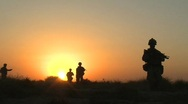 U.S. Marines on Patrol at Sunset c Stock Footage