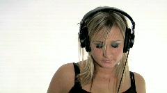Blonde Listening to Music on Headphones Stock Footage