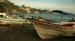 Mex fishing boats and shore at dusk 036 Stock Footage
