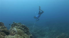Spear fisherman shots fish in the reef and surfaces Stock Footage