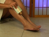 Applying Lotion to Legs (1) Stock Footage