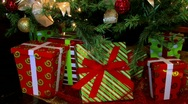 Stock Video Footage of Christmas gifts under a Christmas tree.