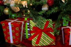 Christmas gifts and presents under a Christmas tree.  Pan Up - stock footage