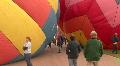 Walking Between Hot Air Balloons HD Footage