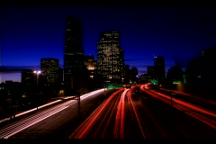 Speeding city traffic at night Stock Footage
