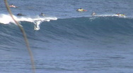 Surfer rides Jaws in Maui, high flying exit. Stock Footage